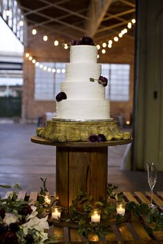 Photography: Berg Photography  Venue: Silver Lake Ballroom  Props: Pursuing Eden Rentals  Flowers: Mandy Cathey Weddings  Dress: Her's Bridal and Special Occasion  Cake: Silver Palate Cakery  Hair: Hair by Allysonn  Makeup: Makeup by Alicia Anne