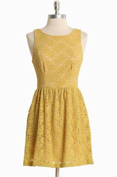 "Afternoon Sunshine Lace Dress 45.99 at shopruche.com. A playful hint of peach peeks through a floral lace overlay in mustard for feminine style. Perfected with a hidden back zipper closure and a hint of stretch for a comfortable and flattering silhouette. Fully lined.Shell: 95% Nylon, 5% Spandex, Lining: 100% Polyester, Made in USA, 32"" length from top of shoulders"