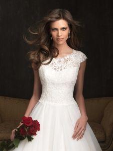 Beautiful modest wedding dress- love the top!