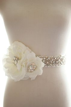 I'm loving the combo of the bling belt AND the flower. But I'd want smaller more subtle crystals in the flower centers
