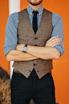 Small print plaid and tweed vest with dark tie. Note: Collar buttons are buttoned. Looks very professional.