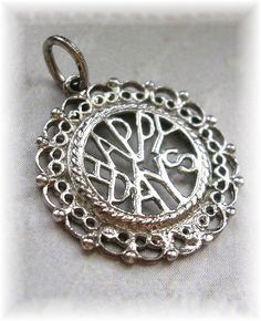 Happy days are here again! A lovely filigree sterling silver Happy Days charm pendant. Measures 3/4Dia. Marked Ster on the back and Sterling on the