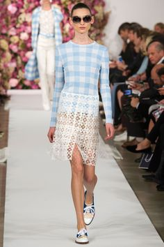 "And gingham, that dark-horse of a top trend, showed up here. Oscar's spin on it was two-fold: sweet-and-pretty in a car coat and Sixties-style shell and shorts, sweet-and-sexy, worn as a shirt tucked into a sheer lace skirt or as a cropped top over a half-sheer skirt. (But seriously, did designers call each other six months in advance and say, ""gingham for all!"")   - HarpersBAZAAR.com"