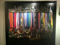 "Now, this is how you hang your race bling! A black board with a frame around it to make the medal display ""Pop""! Love it! #Run #DIY #RaceMedals"
