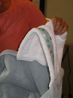 hoodie towel tutorial from Make It Do.  all you need is a bath towel and matching (or mix it up) hand towel and some ribbon or scrap fabric.  great gift!