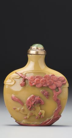 A CINNABAR-RED OVERLAY CARAMEL-BEIGE GLASS 'THREE GOATS' SNUFF BOTTLE<br>YANGZHOU, QING DYNASTY, 19TH CENTURY | lot | Sotheby's