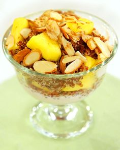 Pineapple-Red Quinoa Parfait    1/2 teaspoon ground cinnamon  6 ounces plain fat-free Greek or soy yogurt, preferably organic  1 cup fresh pineapple, cut into chunks  1/2 cup cooked red quinoa, chilled  2 tablespoons sliced almonds
