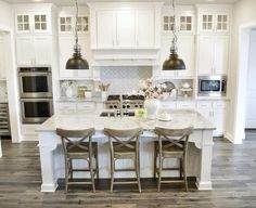 White Farmhouse Paint Color and Flooring. White kitchen paint color is Sherwin Williams Pure White. Farmhouse flooring is Kentwood Floors engineered oak wood floors. Style is called Oak Iron Springs and the color is Wild Thing #SherwinWilliamsPureWhite My Texas House @MyTexasHouse