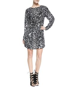 This Neiman Marcus white leopard print long sleeve dress is on trend with animal print.