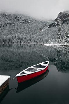 Canoe and Fresh Snow on Lake O'Hara - by Lee Rentz