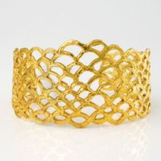 B0101  $  Description    sterling silver + 18K yellow gold plate $700  30 mm (width of the highest spot) one size only  out of stock - it takes about 2-3 weeks.    *sterling silver $560 - in stock    *18K yellow gold : price upon request