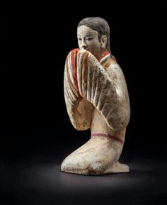 This clay figure of a crouching lady dates back at least 1800 years ago and was found in the tomb of a royalty.   The hairstyle and clothing patterns are relatively simple compared to other times of China as there are rarely any pattern or accessories. The crouching position reflects the habit of early Han people. Early Han people, especially women, rarely sit kneeling and crouching, like the Japanese, were most commonly seen from relics.