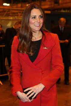 Pin for Later: Kate Middleton's Maternity Style Moments Just Keep Getting Better Kate Middleton Style Inside, Kate Middleton shed her plaid scarf and showed off a polished Armani-coat look, complete with a gold pin on her lapel.