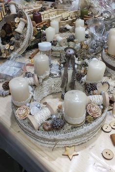 .snowman, wooden spools, lace and twine for a texture rich advent wreath