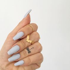 Matte baby blue nails are a new take on a neutral for a winter manicure!