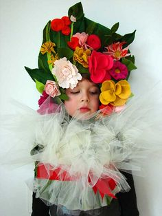 This is our 3 year old posing in his sister's flower bouquet costume.  He loves it.  :) Read more on Aesthetic Outburst.