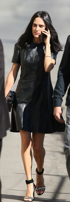 Who made Jennifer Connelly's black leather dress and clutch handbag?
