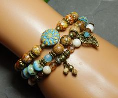 Nature, Rustic and Boho Style set of 3 bracelets: ~ Top Bracelet features a pretty Sun focal bead surrounded by Rustic Czech Glass. ~ Middle Bracelet is made with an antique bronze Leaf Charm with a h