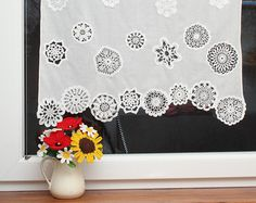 This short ecru curtain is unique window decoration. The curtain is made of cotton fabric and decorated with beautiful crochet doilies. Each doily is crochet by hand and sewn to curtain with the highest precision. Its very timeconsuming but the effect is worth the work.  The curtain dimensions in options are width x height respectively.  All my products are made of excellent quality yarn (100% cotton yarn) with the highest precision and accuracy.  Please know that this curtain is totaly…