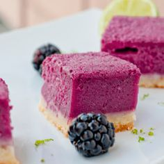 blackberry lime bars from theimprovkitchen.co - Tangy, vibrant, subtly sweet with a rich, buttery crust. These blackberry lime bars are the perfect summer dessert.