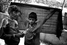 Mohammed, a 15-year-old addict, watches closely while an older addict prepares an injection. For young addicts the relationships to the older and more experienced users can mean safety and danger at the same time. Crime and violence among the users is quite common.