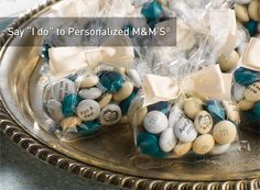 Wedding favors from MY M'S®: Celebrate Your Wedding! I just ordered mine and recieved the order in less than a week. Wedding colors and all. Just buy small heart tins from Michaels and fill them with your personalized wedding m's. Great Idea!