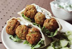 "The last time I made falafel was for a family dinner night. My dad kept calling them ""matzo balls"" which I thought was funny. Falafel is a little bit time consuming but SOOOO worth the effort. This is a great recipe to impress your significant other or your next dinner party guests—if they like food that's awesome. Falafel, makes about 25 balls. :) 2 cans chickpeas (each can is 15..."