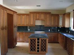 coffee glazed maple cabinets with black granite