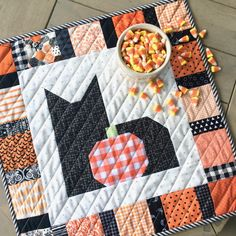 Halloween mini quilt with black cat and pumpkin block.