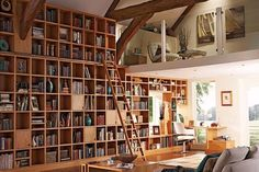 Home Library Design With Grey Sofa And The Ladder ~ http://lanewstalk.com/how-to-acquire-the-best-library-design-at-home/