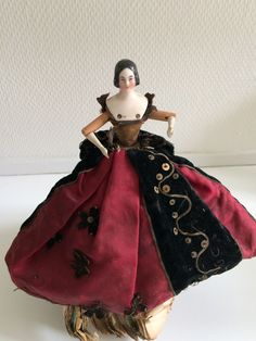 Peg wooden China head doll,dressed as a fortune teller doll. French Market. Ca 1840. Lovely modeling with black hair and free ears.. She is on a stand and the Papers are in french.. Original dress, velvet bodice. Wonderful skirt.