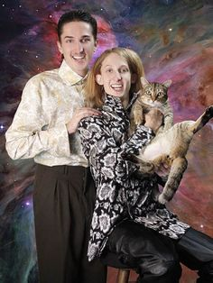 wow.  So much to draw my eye - her EAR, the cat's crotch, her EAR, their coordinated outfits, her EAR.  Oh my