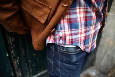 Jeans, red-blue-white plaid and tan.
