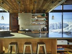 """A Steel-and-Glass Compound Is One Family's Launchpad For Adventure - Photo 4 of 10 - Wood siding salvaged from an old barn in Spokane, Washington, was repurposed for the project. """"The varying tones of the wood reveal its history and use,"""" says Kundig. Throughout the home, common materials are employed in fresh ways, such as exposed plywood used in the flooring and walls."""