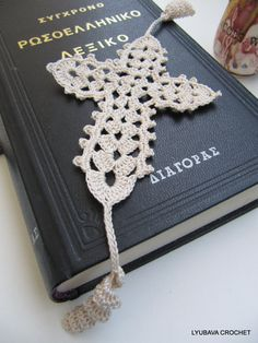 Crochet Cross Bookmark Pattern INSTANT DOWNLOAD. This is SIMPLE TUTORIAL CROCHET PATTERN PDF file with written instructions in American crochet terms, with tutorial pictures showing the stitches row by row made it so much easier to work with the pattern even for the beginner.  Skill Level: Easy. Finished Measurements 2 Sizes available: 1) 7 in x 5.5 in (17 cm x 13.5 cm) 2) 4.5 in x 3.5 in (11.5 x 9 cm) without tassels. Make a lovely handmade crochet gift! Happy Crocheting!  PDF FILE…