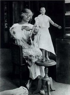 Madeleine Vionnet experimenting with bias cutting on a small mannequin.