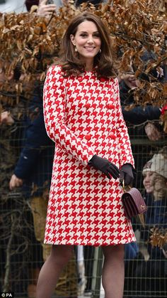 Quick change: The Duchess removed her red houndstooth coat