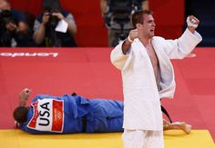 Canada's Antoine Valois-Fortier celebrates after defeating Travis Stevens of the U.S. in men's -81kg bronze medal judo match at London 2012 Olympic Games