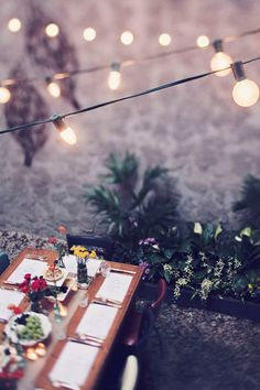 outdoor dinner party setting, complete with cafe lights