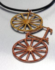 Enamel copper bike pendant in leather cord.
