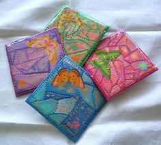 4 colorful butterfly coasters, resin covered. Polymer clay, adhesives, resin covered, basis from foamy glittering sheet. by klio1961