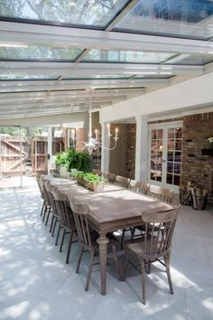 The formal dining room of the newly renovated Ferguson home was moved to the sunporch, the new fireplace and dining room table bring this room to life, as seen on Fixer Upper. (after)