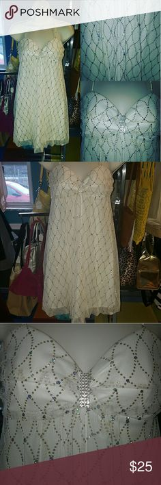 BCX Baby doll Cocktail dress Excellent condition BCX white baby doll cocktail dress with glittery fabric and crystal embellishment. In excellent condition! Perfect for a semi formal, wedding, graduation! Get an amazing look for NO money! BCX Dresses