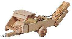 Amish Wooden Toy Hay Baler with Hitch Solid Wood Crafts and Toys Collection Watch your children as they scurry around the room, baling hay and keeping up with the fields!  The Amish Woo