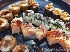 A meal with variety of sushi, cold and hot