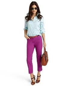 Love the pop of color in these magenta pants with the pale blue shirt and camel handbag!