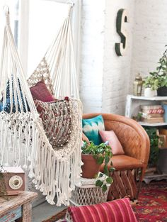 Macramé Hammock: After a decades-long hiatus, the trendy textile is back in a big way. Check out a few of our favorite macramé creations.