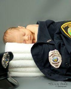 Baby in Cop Shirt. How sweet
