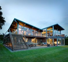 Bates Masi Architects designed this sprawling glass and wood house which, while natural in its materials and overall aesthetic, features tons of unusual architectural features that offer an awesome element...