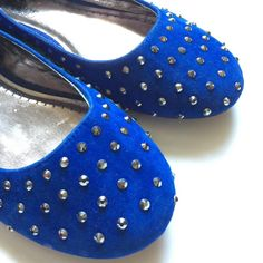 NWOT Blue Studded Flats Never wore them. Little snug for me but I'm a 10.5 in my opinion so I take chances with size 10 shoes. Velvet in texture with metallic studs all over. Some studs are missing. I don't remember if they came that way bc you don't notice upon first glance. Shoes Flats & Loafers